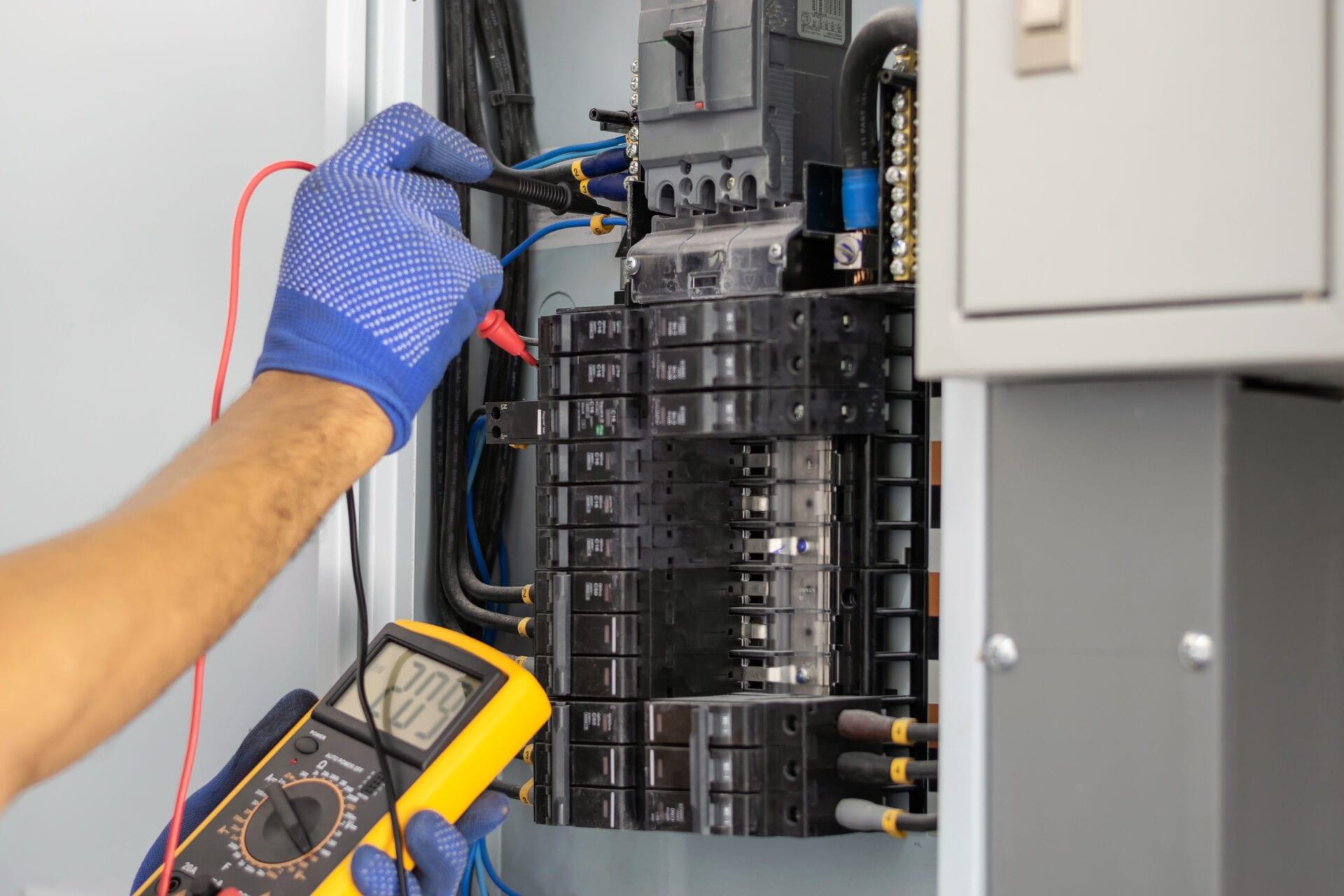 Electrician repairing electrical panel